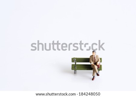 Miniature thinking man - stock photo