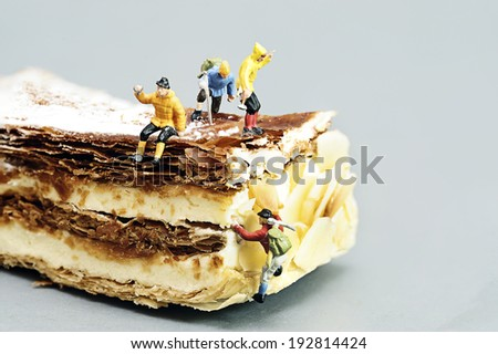 Miniature toy climber with cake - stock photo