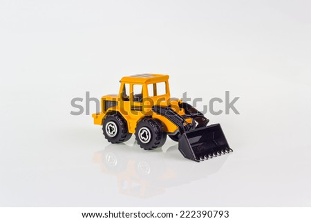 miniature toy of steer loader for industrial in isolated