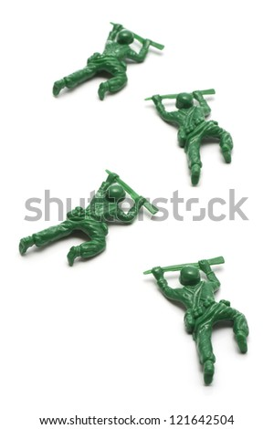 miniature toy soldiers advancing creeping on white background - stock photo