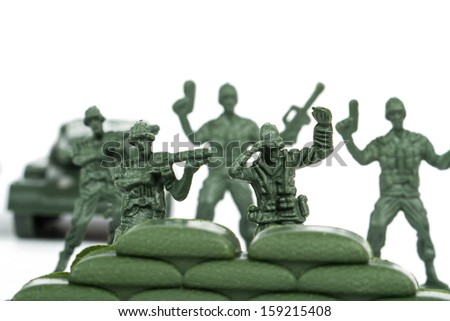 Miniature toy soldiers, isolated on white background. - stock photo
