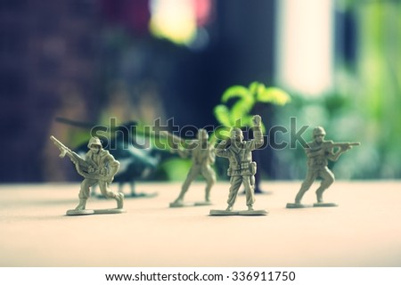 miniature toy soldiers on board - stock photo