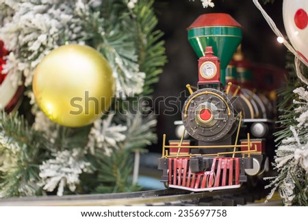 Miniature train with Christams decoration - stock photo