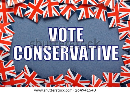 Miniature Union Jack flags form a border on blue card around the phrase Vote Conservative for the  UK General Election - stock photo