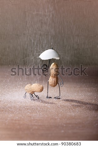 Miniature with Peanut Man and Dog under umbrella - stock photo