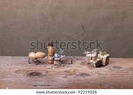 Miniature with Peanut People on Christmas unpacking their presents - stock photo