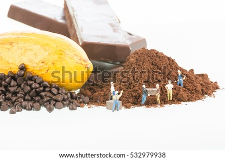Miniature workers and cocoa over white background