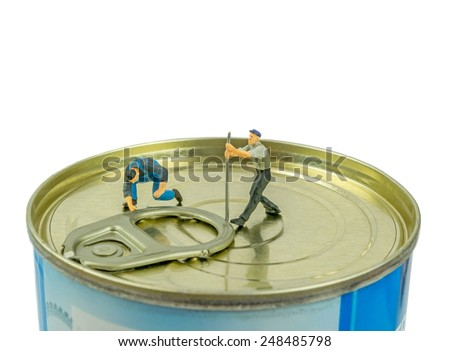 Miniature workmen trying to open the ring pull on a tin of food