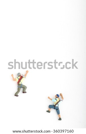 miniatures of climbers on a white background - stock photo