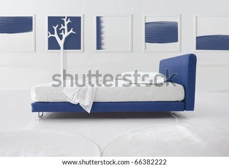 minimal blue bedroom - stock photo