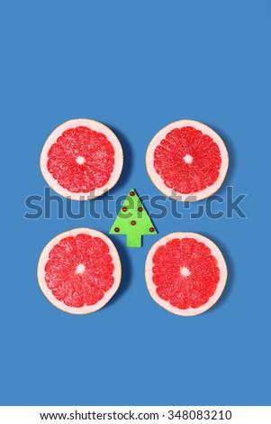 Minimal Design. Fresh Grapefruit with Christmas Decor - stock photo