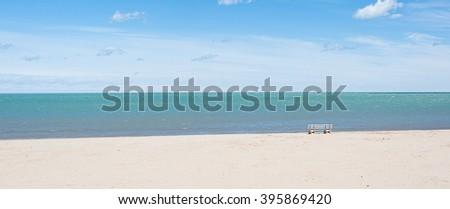 Minimal space chair on the beach - stock photo
