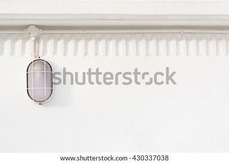 Minimalism style, Beautiful Minimal lamp light attach with white wall texture background. Design, visual art, minimalism. - stock photo