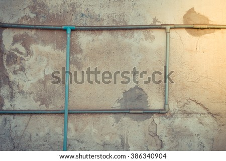 Minimalism style, Dirty green water pipe on the old wall texture background. , process in vintage style - stock photo