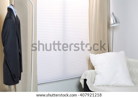 Minimalist bright room for young business person. New bachelor studio apartment. Minimalistic design. - stock photo