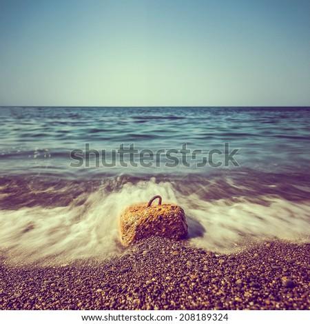 Minimalist misty seascape with rocks at long exposure - stock photo