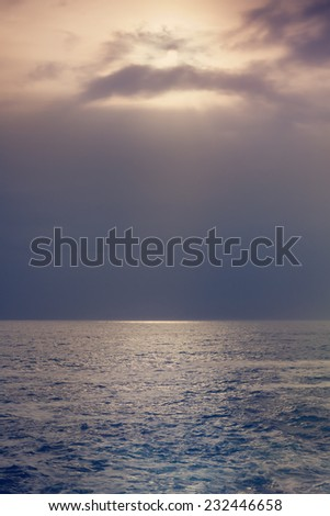 minimalist seascape, sunset at sea - stock photo