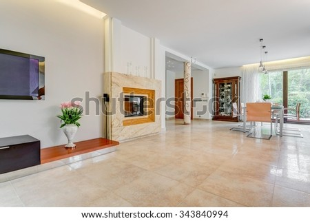 Minimalistic fireplace in moderrn house with marble floor - stock photo