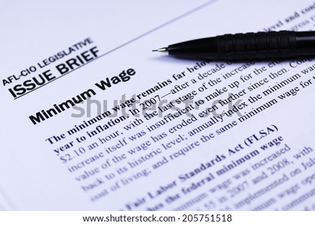 Minimum wage article close up with a pen - stock photo