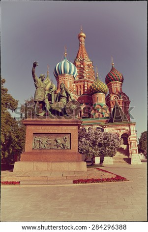 Minin and Pozharsky in front of St. Basil's Cathedral in Moscow, Russia. vintage style - stock photo