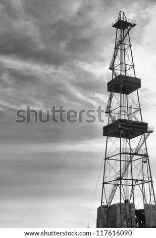 mining derrick and dark sky - stock photo