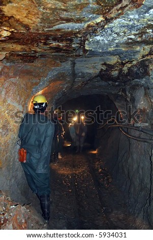 Mining - Miners pushing a tram in the dark