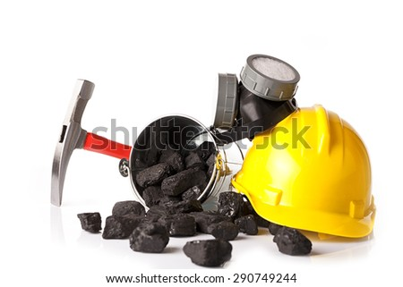 Mining tools with protective helmet, ear muffs and pickaxe - stock photo