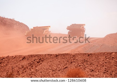 Mining truck working in iron ore mines, Western Australia - stock photo