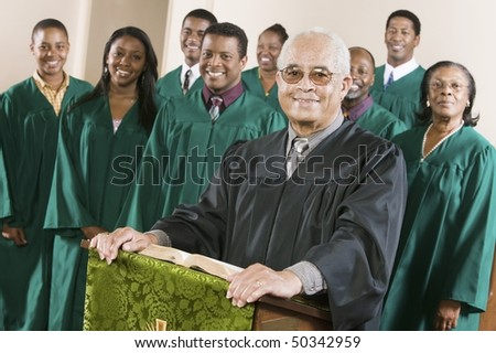Minister at podium with Gospel Choir, portrait - stock photo