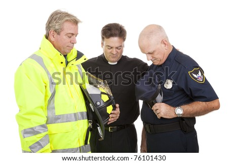Minister prays with a firefighter and police officer at work.  Isolated on white. - stock photo