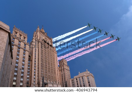 Ministry of Foreign Affairs of the Russian Federation and Russian military aircrafts fly in formation, Moscow, Russia   - stock photo