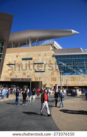 MINNEAPOLIS - APRIL 22: Fans arrive at Target Field, home of the Minnesota Twins, on April 22, 2010 in Minneapolis, Minnesota. The ballpark opened in 2010 and seats 39,504. - stock photo
