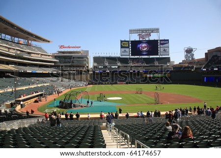 MINNEAPOLIS - APRIL 22: Twins fans watch batting practice in the sunshine at new Target Field, a ballpark that returns outdoor baseball to the city, on April 22, 2010 in Minneapolis, Minnesota. - stock photo