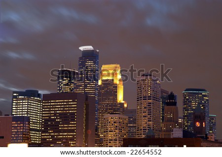 Minneapolis city skyline at dusk with moving clouds