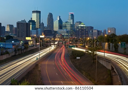 Minneapolis. Image of Minneapolis skyline and highway with traffic lines leading to the city.