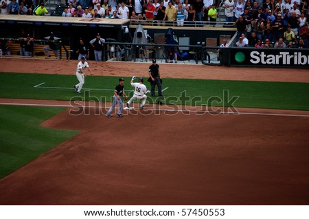 MINNEAPOLIS - JULY 17:  Jason Kubel of the Minnesota Twins slides safely into third base in a game against the Chicago White Sox at Target Field July 17, 2010 in Minneapolis, MN. - stock photo