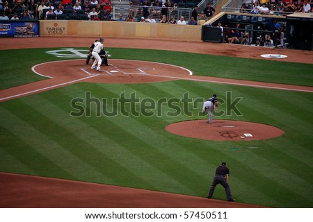 MINNEAPOLIS - JULY 17:  Joe Mauer of the Twins bats against Mark Buehrle of the White Sox in a game at Target Field July 17, 2010 in Minneapolis, MN. - stock photo
