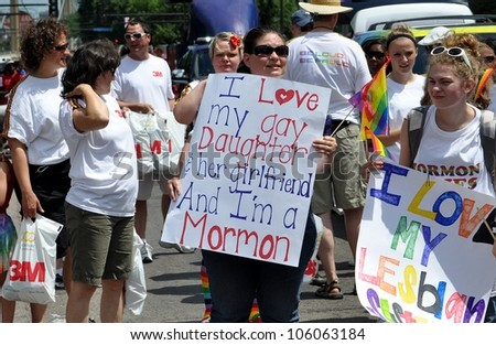 MINNEAPOLIS - JUNE 24:  A Mormon Mother proclaims love for her Gay Daughter at the Twin Cities Gay Pride Parade on June 24, 2012, in Minneapolis. - stock photo