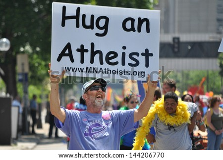 MINNEAPOLIS - JUNE 30:  An Unidentified Atheist marches in the Twin Cities Gay Pride Parade on June 30, 2013, in Minneapolis. - stock photo