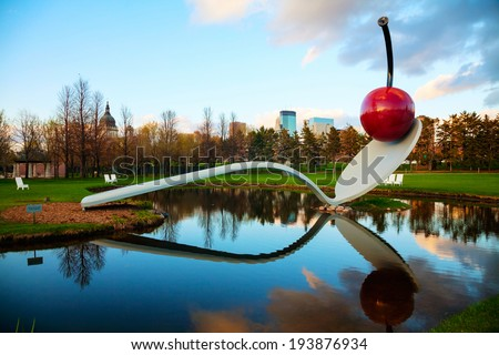 MINNEAPOLIS - MAY 14: The Spoonbridge and Cherry at the Minneapolis Sculpture Garden on May 14, 2014 in Minneapolis, MN. It is one of the largest urban sculpture gardens in the country. - stock photo