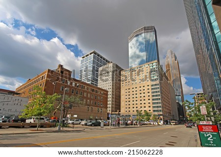 MINNEAPOLIS, MINNESOTA - AUGUST 11 2014: Skyscrapers and activity on S Marquette Ave in downtown Minneapolis, the seat of Hennepin County and the largest city in Minnesota with over 400,000 residents. - stock photo