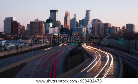 MINNEAPOLIS, MINNESOTA/UNITED STATES - MARCH 27: The highway carries rush hour commuters in and out of downtown at sunset on 03/27/2015 in Minneapolis.