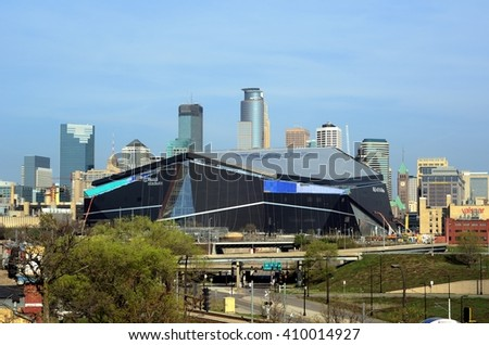 MINNEAPOLIS, MN - APRIL 23 2016: Minnesota Vikings US Bank Stadium in Minneapolis with Downtown Skyline
