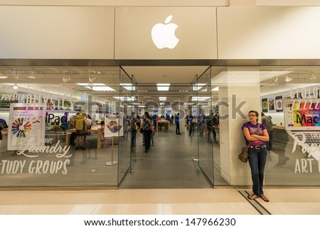 MINNEAPOLIS, MN - JULY 28: Apple store in Mall of America, in Minneapolis, MN, on July 28, 2013. The company was founded by Steve Jobs in 1976, and it is currently the richest company in the world. - stock photo