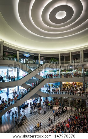 """MINNEAPOLIS, MN - JULY 28:  Mall of America stage circle, on July 18, 2013, in Minneapolis Minnesota. People gather on several levels and stand in lines for the authors of the book """"Mortal Instrument"""" - stock photo"""