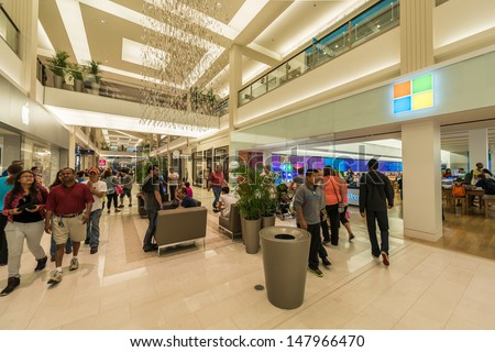 MINNEAPOLIS, MN - JULY 28:  Microsoft and Apple store right next to each other in Mall of America, in Minneapolis, MN, on July 28, 2013. Competition is furious between the two stores. - stock photo