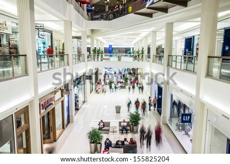 MINNEAPOLIS,MN - SEPTEMBER 26: Busy corridor in Mall of America, in Minneapolis, MN, on September 26, 2013. Mall of America receives over 40 million visitors per year. - stock photo
