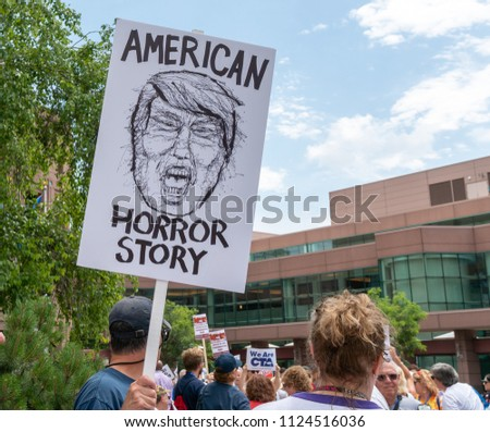MINNEAPOLIS, MN/USA - JUNE 30, 2018: Unidentified individuals participating in the Families Belong Together march in protest of U.S. Immigration policy separating migrant children from parents.