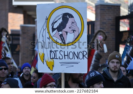 MINNEAPOLIS - NOVEMBER 2: Protesters at the Change the Mascot Rally on November 2, 2014, in Minneapolis.  The protesters believe the name Washington Redskins is offensive to Native Americans. - stock photo