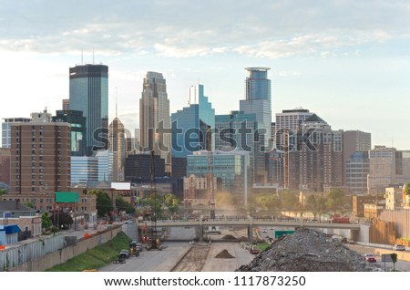 minneapolis skyline from 24th street pedestrian bridge overlooking 35w interstate into downtown showing reconstruction of interstate and office towers of downtown in distance